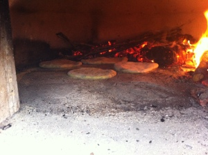 Firing a batch in the oven, with the fire shifted to one side of the oven