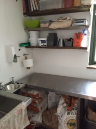The dough table, ingredients and tools over, flour store under