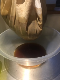 Draining the steeped mash